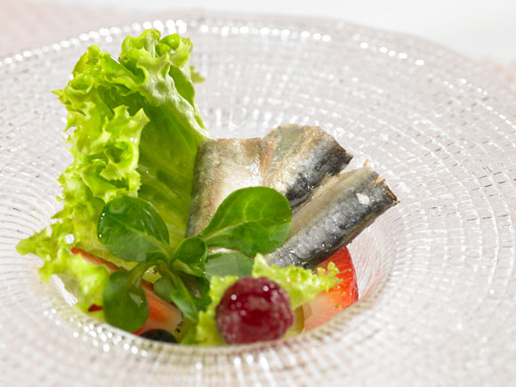 Small sardines in red fruit salad